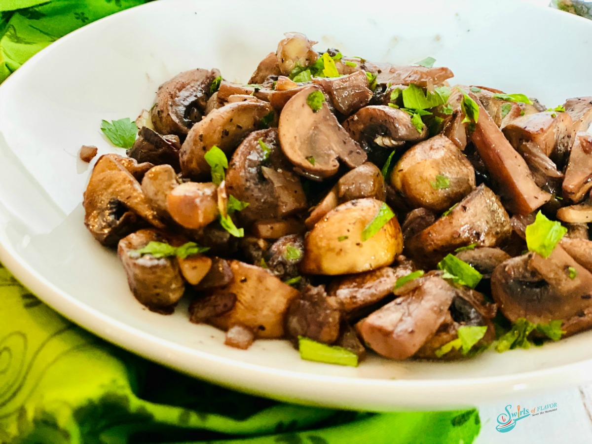 easy sauteed mushrooms and onions in a white bowl