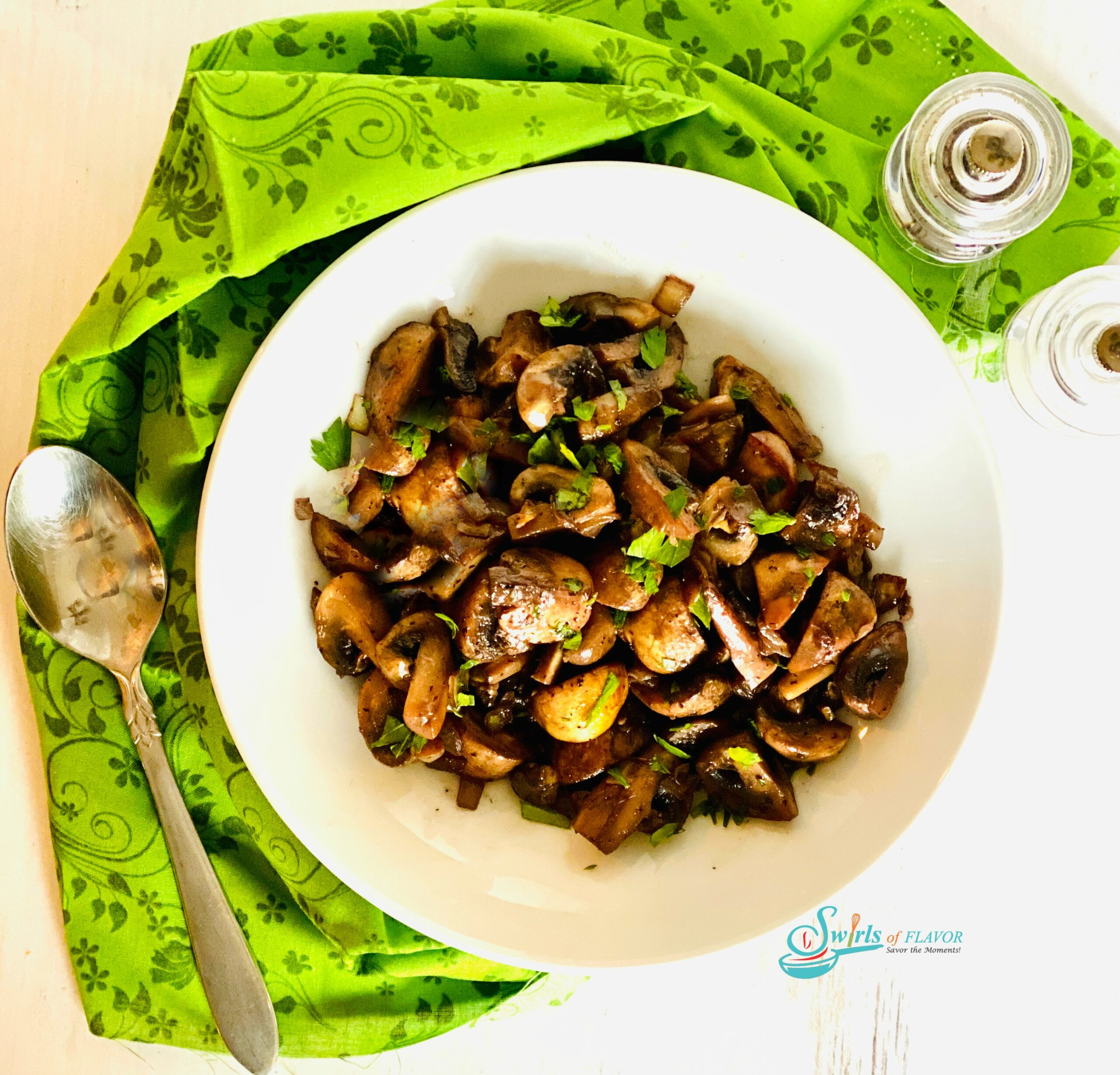 overhead photo of a mushroom side dish with spoon and napkin