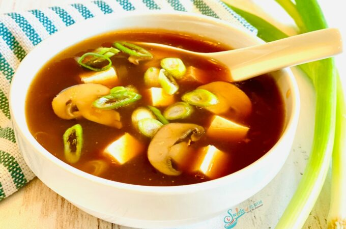 bowl of hot and sour soup with spoon