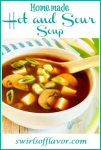 hot and sour soup in white bowl with text overlay