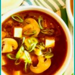 Asian soup with tofu and text overlay
