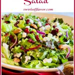 holiday salad with cranberries and text overlay