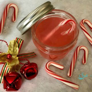 candy cane vodka in mason jar with mini candy canes