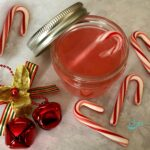 peppermint vodka in mason jars with candy canes