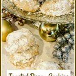 cookies with pecans and confectioners sugar and text overlay