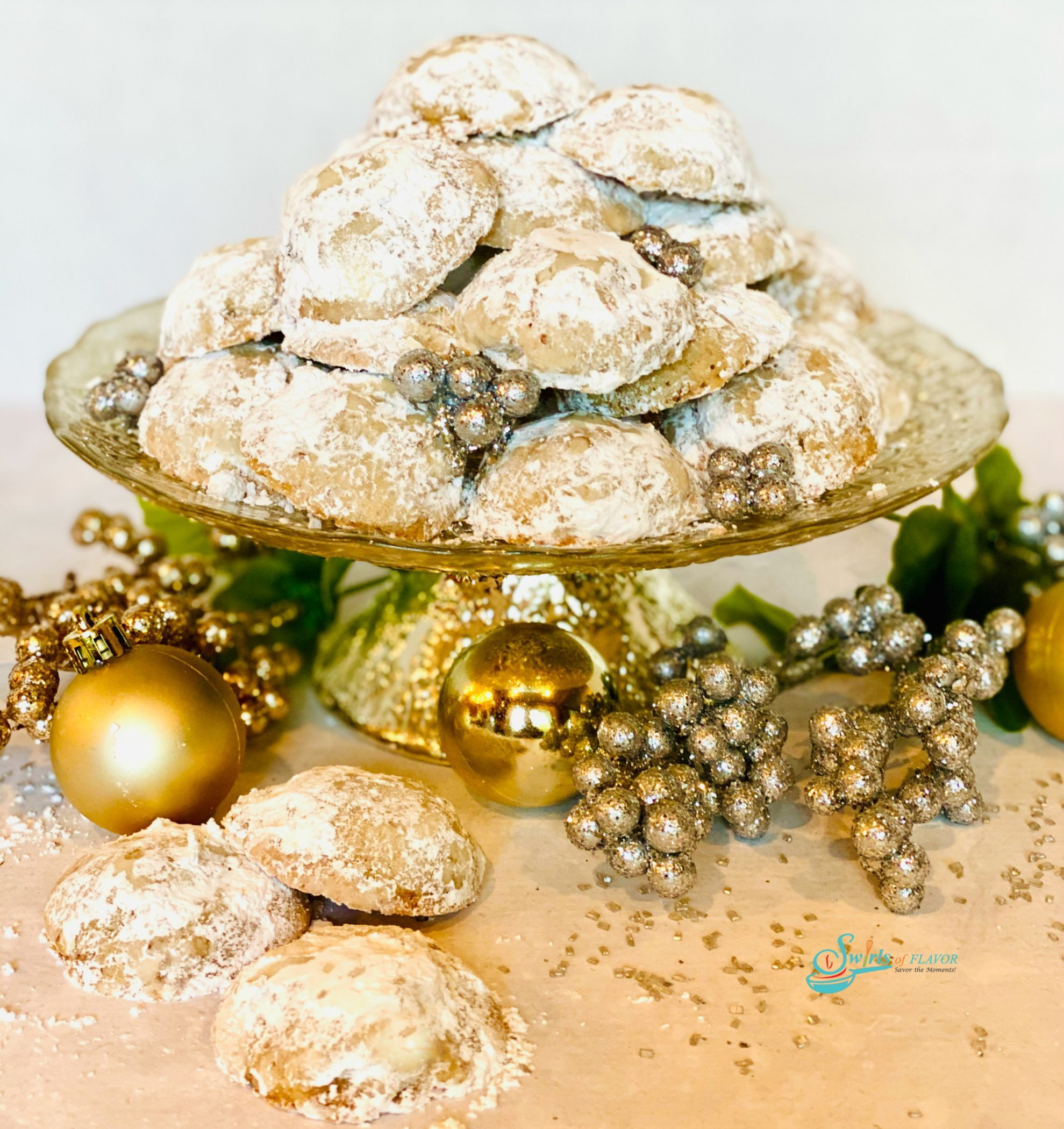 snowball cookies on a cake stand with ornaments
