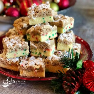 Christmas Crumb Cake on red plate with ora=naments