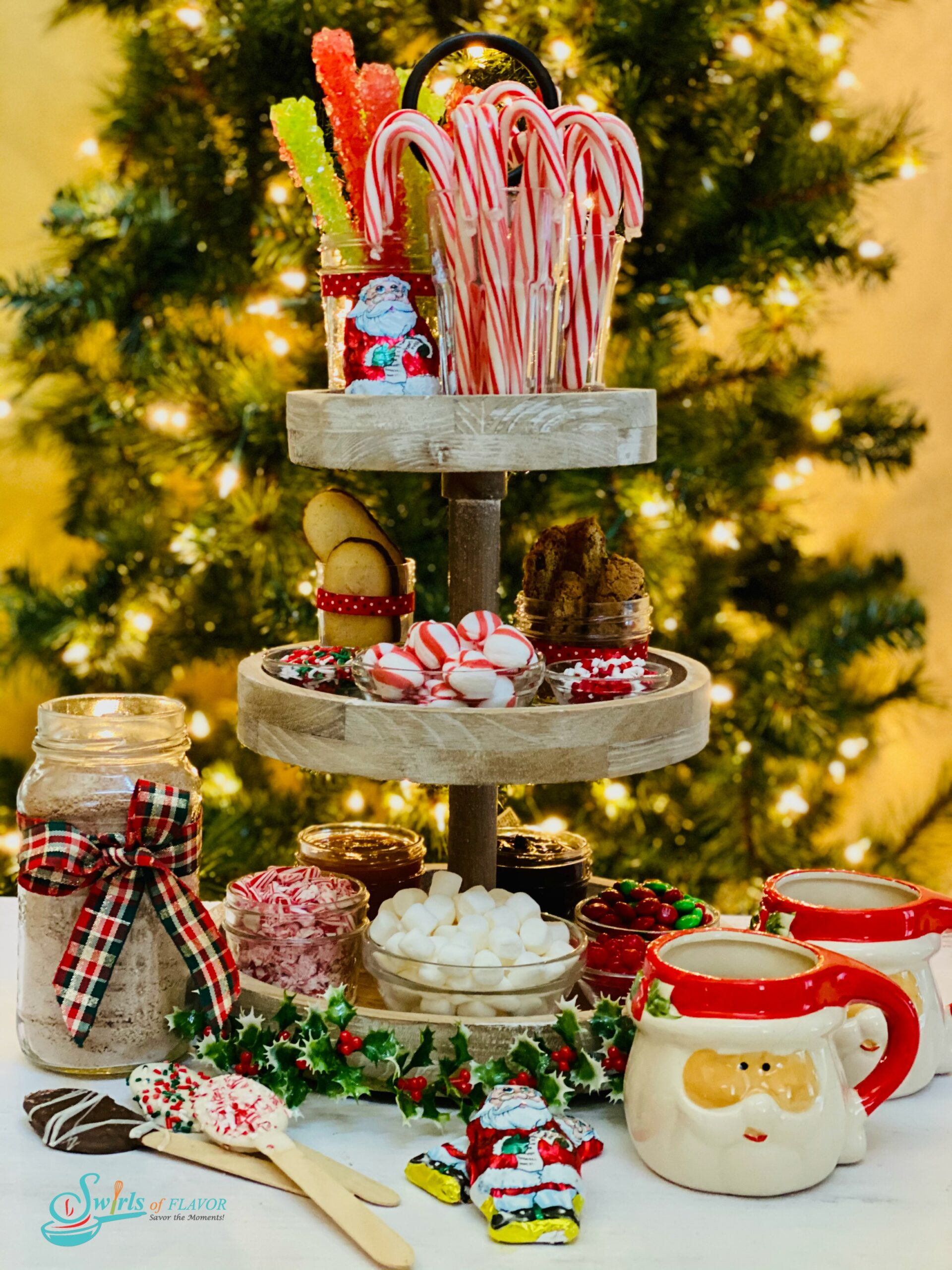 three tier tray with hot cocoa bar ingredients