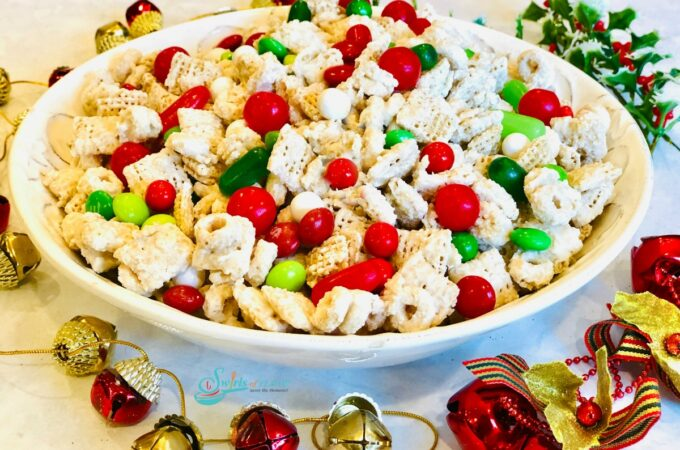bowl of reindeer chow with holiday decorations