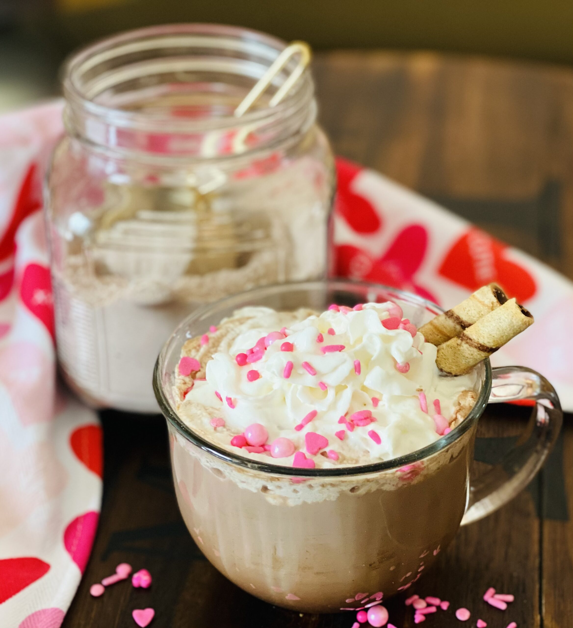 homemade hot chocolate mix in a jar with mug of hot cocoa