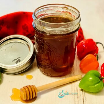 homemade hot honey in mason jar with fresh peppers