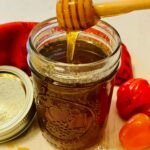 hot honey in mason jar with drizzle of honey
