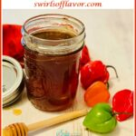 homemade hot honey with fresh peppers and text overlay