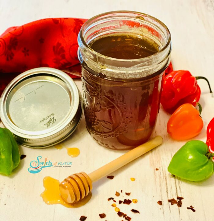 hot honey in mason jar with fresh peppers
