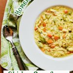 chicken orzo soup in bowl with spoon and green napkin and text overlay