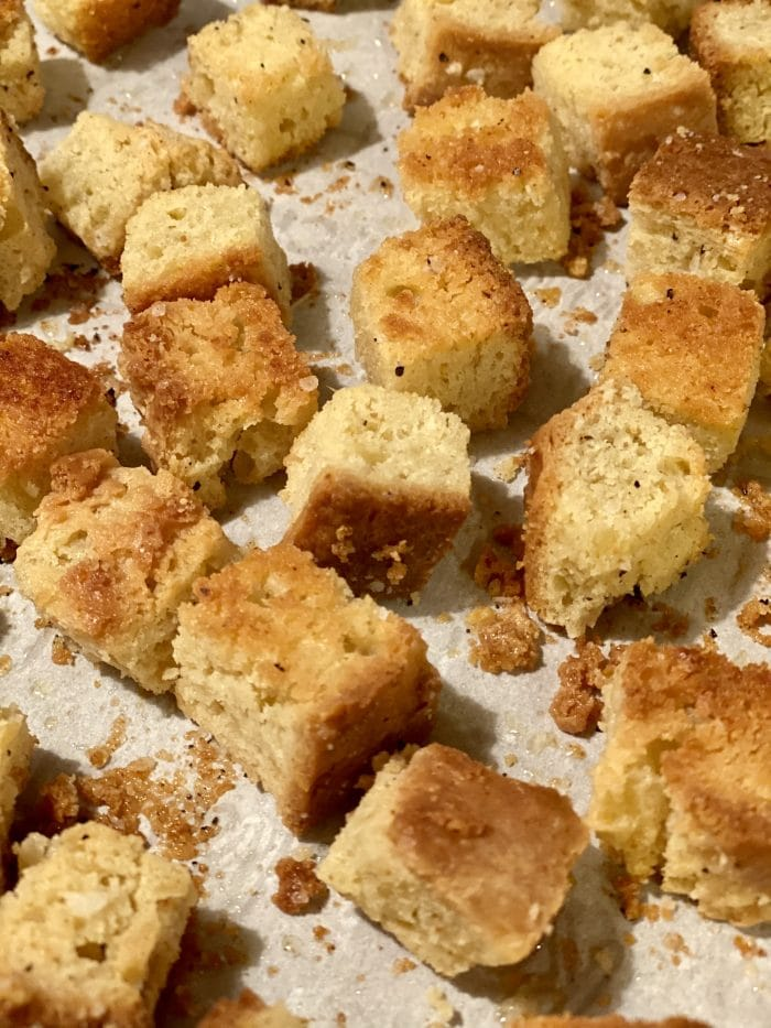 baked homemade croutons on baking sheet