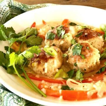 one pot chicken meatballs recipe in white bowl with napkin