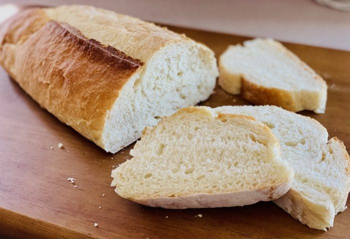 loaf of store bought bread with slices