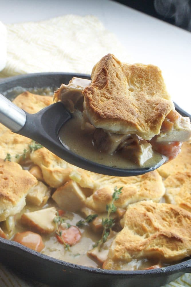 chicken casserole with spoon and scoop out