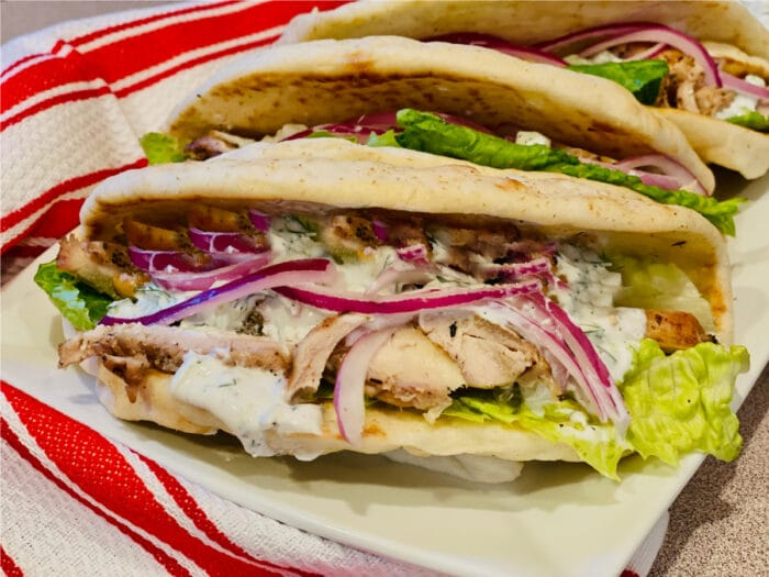 close up of a chicken gyro sandwich on pita bread