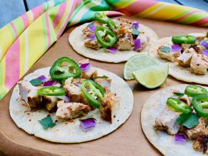 chicken street tacos on a wooden board