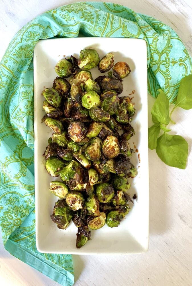 overhead of glazed brussel sprouts in rectangular white dish