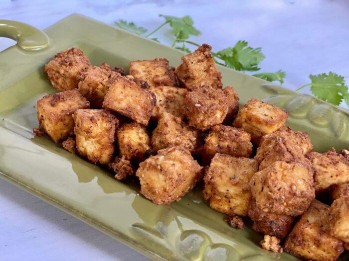 air fryer tofu on green platter