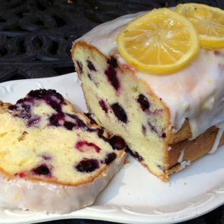 blueberry pound cake with slice on white platter