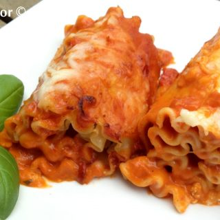 Take the ordinary out of dinner tonight with Lasagna Roll-Ups all Vodka, an easy recipe that you can make ahead! Top lasagna noodles with cheese, roll up and bake with vodka sauce! Perfect for your Meatless Monday, your Sunday Supper, your weeknight dinner and fancy enough for entertaining! #lasagna #vodkasauce #lasagnarollups #makeahead #pasta #easyrecipe #meatlessMonday #entertaining #dinner #swirlsofflavor
